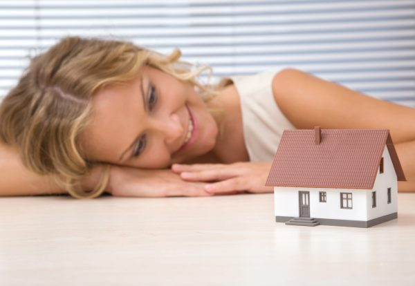 businesswoman with house